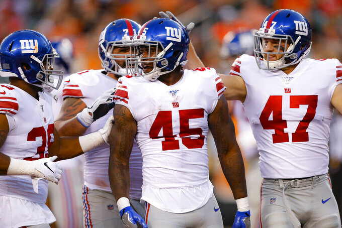 New York Giants running back Rod Smith (45) celebrates his touchdown withteammates during the first half of an NFL preseason football game against the Cincinnati Bengals, Thursday, Aug. 22, 2019, in Cincinnati. (AP Photo/Gary Landers)