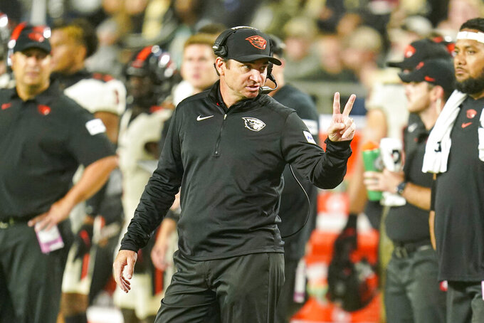 Oregon State head coach Jonathan Smith gestures on the sideline during the first half of an NCAA college football game against Purdue in West Lafayette, Ind., Saturday, Sept. 4, 2021. (AP Photo/Michael Conroy)