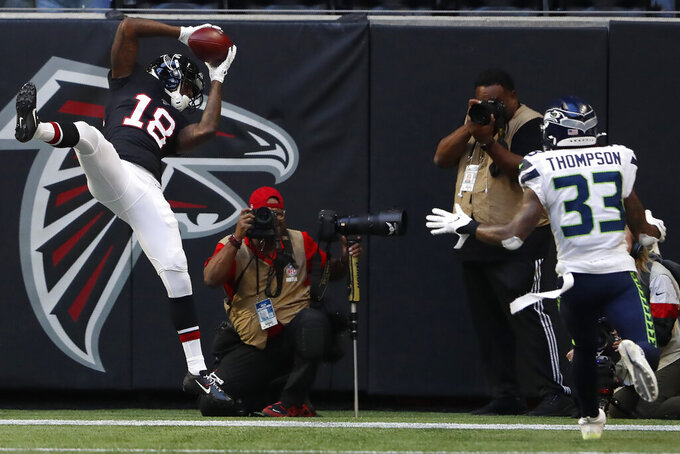 tlanta Falcons wide receiver Calvin Ridley (18) makes the catch for a two-point conversion against Seattle Seahawks free safety Tedric Thompson (33) during the second half of an NFL football game, Sunday, Oct. 27, 2019, in Atlanta. (AP Photo/John Bazemore)