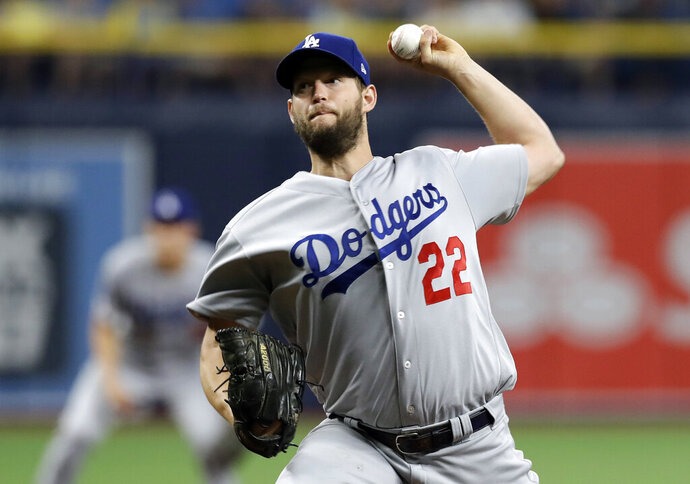 Los Angeles Dodgers starting pitcher Clayton Kershaw delivers to the Tampa Bay Rays during the first inning of a baseball game Tuesday, May 21, 2019, in St. Petersburg, Fla. (AP Photo/Chris O'Meara)