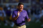 FILE - In this Aug. 31, 2019, file photo, LSU head coach Ed Orgeron gestures before an NCAA college football game against Georgia Southern, in Baton Rouge, La. Texas coach Tom Herman and LSU coach Orgeron like the colors they'll be wearing Saturday night when No. 6 Tigers meet No. 9 Texas in one of the top non-conference matchups of the 2019 season. (AP Photo/Tyler Kaufman, File)