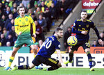 Norwich City's Todd Cantwell, left, scores his side's second goal of the game against Arsenal during their English Premier League soccer match at Carrow Road in Norwich, England, Sunday Dec. 1, 2019. (Adam Davy/PA via AP)