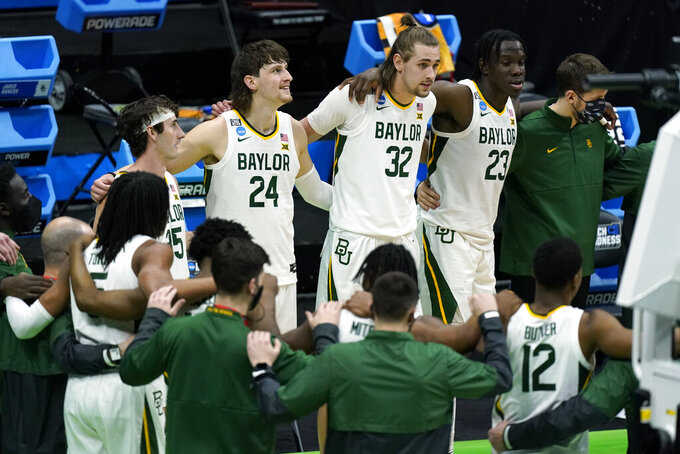 Baylor players gather together after beating Hartford in a college basketball game in the first round of the NCAA tournament at Lucas Oil Stadium in Indianapolis Friday, March 19, 2021, in Indianapolis, Tenn. (AP Photo/Mark Humphrey)