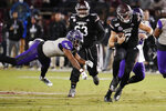 Mississippi State quarterback Tommy Stevens (7) evades an Abilene Christian defender as he runs for short yardage during the first half of an NCAA college football game, Saturday, Nov. 23, 2019, in Starkville, Miss. (AP Photo/Rogelio V. Solis)