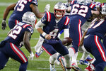 New England Patriots quarterback Jarrett Stidham (4) hands off to running back J.J. Taylor in the second half of an NFL football game against the Buffalo Bills, Monday, Dec. 28, 2020, in Foxborough, Mass. (AP Photo/Charles Krupa)