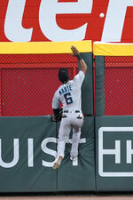 Miami Marlins center fielder Starling Marte (6) can't reach a ball hit for a three-run home run by Atlanta Braves' Dansby Swanson in the fourth inning of a baseball game Wednesday, Sept. 23, 2020, in Atlanta. (AP Photo/John Bazemore)