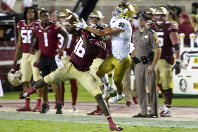 Florida State defensive back Travis Jay (18) breaks up a pass intended for Notre Dame wide receiver Braden Lenzy (0) in the second quarter of an NCAA college football game Sunday, Sept. 5, 2021, in Tallahassee, Fla. (AP Photo/Phil Sears)