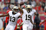 New Orleans Saints wide receiver Ted Ginn Jr., (19) celebrates his touchdown against the Tampa Bay Buccaneers with wide receiver Michael Thomas (13) during the second half of an NFL football game Sunday, Nov. 17, 2019, in Tampa, Fla. (AP Photo/Jason Behnken)