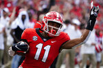 Georgia wide receiver Arian Smith (11) gestures as he scores after a catch during the first half of an NCAA college football game against UAB, Saturday, Sept. 11, 2021, in Athens, Ga. (AP Photo/John Bazemore)