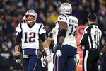 New England Patriots quarterback Tom Brady (12) heads off the field after being sacked by Baltimore Ravens defensive end Jihad Ward on a third down play in the second half of an NFL football game, Sunday, Nov. 3, 2019, in Baltimore. The Ravens won 37-20. (AP Photo/Gail Burton)