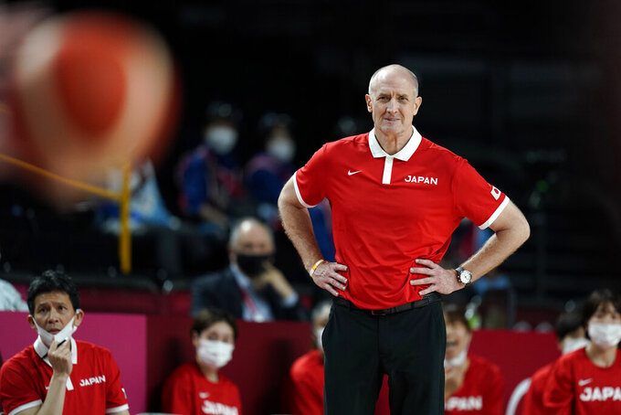 Japan head coach Thomas Hovasse watches from the bench during a women's basketball semifinal round game against France at the 2020 Summer Olympics, Friday, Aug. 6, 2021, in Saitama, Japan. (AP Photo/Charlie Neibergall)