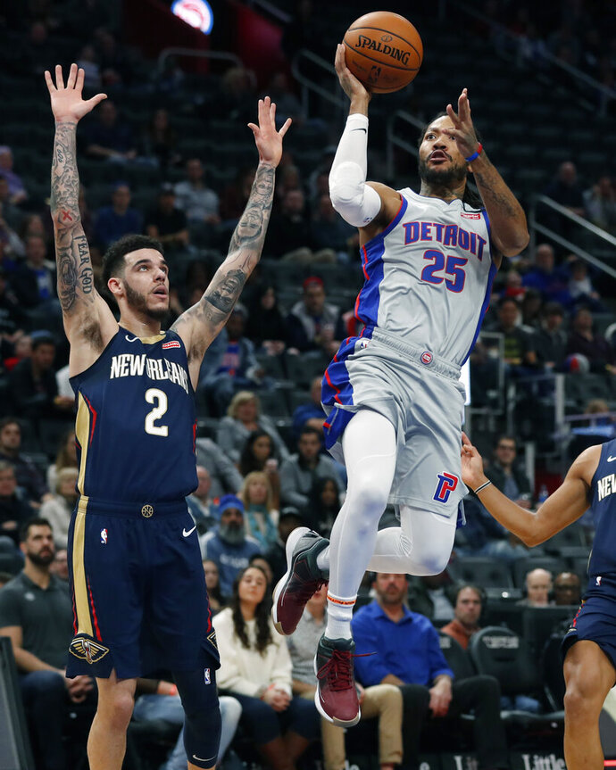 Detroit Pistons guard Derrick Rose (25) attempts a layup as New Orleans Pelicans guard Lonzo Ball (2) defends during the first half of an NBA basketball game, Monday, Jan. 13, 2020, in Detroit. (AP Photo/Carlos Osorio)