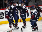 Colorado Avalanche defenseman Nikita Zadorov, second from left, is congratulated after scoring a goal by, from left, left wing Gabriel Landeskog, right wing Mikko Rantanen, center Nathan MacKinnon and defenseman Ian Cole in the first period of an NHL hockey game against the Dallas Stars Tuesday, Jan. 14, 2020, in Denver. (AP Photo/David Zalubowski)