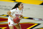 Maryland guard Katie Benzan works the floor against Iowa during the second half of an NCAA college basketball game, Tuesday, Feb. 23, 2021, in College Park, Md. Maryland won 111-93. (AP Photo/Julio Cortez)