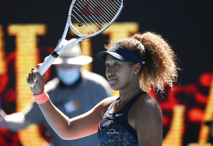 Japan's Naomi Osaka celebrates after defeating United States' Serena Williams in their semifinal match at the Australian Open tennis championship in Melbourne, Australia, Thursday, Feb. 18, 2021.(AP Photo/Andy Brownbill)
