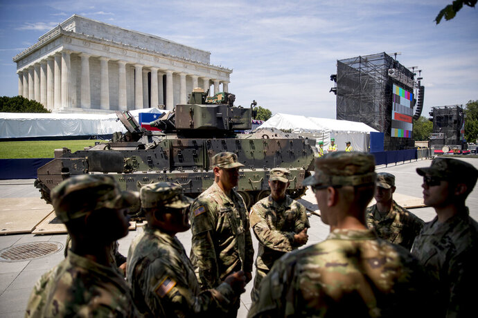 FILE - In this July 3, 2019, file photo one of two Bradley Fighting Vehicles driven into place in front of the Lincoln Memorial for President Donald Trump's 'Salute to America' event honoring service branches on Independence Day in Washington. Government watchdogs say President Trump's 2019 Fourth of July gala in the nation's capital cost taxpayers more than $13 million, twice as much as previous celebrations. (AP Photo/Andrew Harnik, File)
