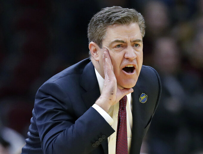 FILE - Central Michigan coach Keno Davis yells instructions to players during the second half of an NCAA college basketball game against Buffalo in the semifinals of the Mid-American Conference men's tournament in Cleveland, in this Friday, March 15, 2019, file photo. Central Michigan has fired men's basketball coach Keno Davis after nine years at the helm. CMU announced the move Monday, April 5, 2021. The Chippewas went 142-143 under Davis and did not make the NCAA Tournament. (AP Photo/Tony Dejak, File)