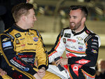 FILE - Tyler Reddick, left, and Austin Dillon talk before the first of two qualifying auto races for the NASCAR Daytona 500 at Daytona International Speedway in Daytona Beach, Fla., in this Thursday, Feb. 14, 2019, file photo. There's one guy Tyler Reddick doesn't expect any help from at Daytona International Speedway on Saturday night: His teammate. Reddick and fellow Richard Childress Racing driver Austin Dillon are essentially battling each other for the 16th and final spot in the NASCAR Cup Series playoffs. And that makes teamwork at the 2½-mile superspeedway downright tricky, maybe even unthinkable, for the duo. (AP Photo/Terry Renna, File)