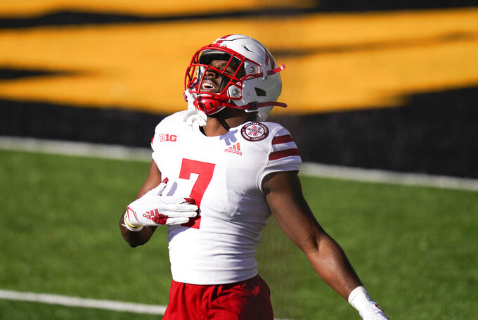 Nebraska cornerback Dicaprio Bootle celebrates after intercepting a pass during the first half of an NCAA college football game against Iowa, Friday, Nov. 27, 2020, in Iowa City, Iowa. (AP Photo/Charlie Neibergall)