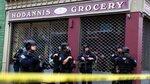 Law enforcement guard near the scene following a shooting, Tuesday, Dec. 10, 2019, in Jersey City, N.J.  AP Photo/Eduardo Munoz Alvarez)