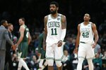 Boston Celtics' Kyrie Irving (11) and Al Horford (42) walks to the bench during a timeout in the second half of Game 3 of the team's second-round NBA basketball playoff series against the Milwaukee Bucks in Boston, Friday, May 3, 2019. (AP Photo/Michael Dwyer)