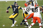 Pittsburgh Steelers quarterback Ben Roethlisberger (7) looks to pass under pressure by Cleveland Browns defensive end Myles Garrett (95) during the first half of an NFL wild-card playoff football game, Sunday, Jan. 10, 2021, in Pittsburgh. (AP Photo/Keith Srakocic)