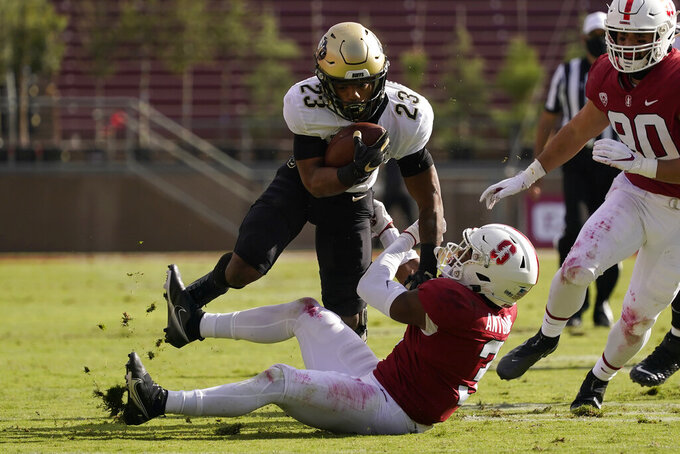 Colorado running back Jarek Broussard (23) runs against Stanford safety Malik Antoine, bottom, during the first half of an NCAA college football game in Stanford, Calif., Saturday, Nov. 14, 2020. (AP Photo/Jeff Chiu)
