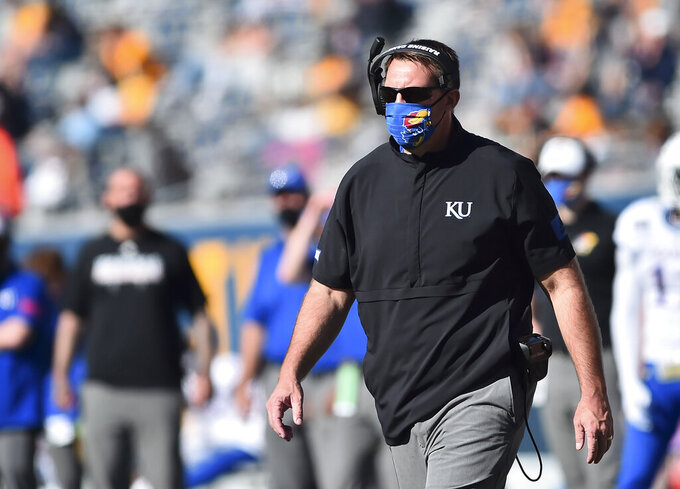 Kansas acting head coach Joshua Eargle looks on against West Virginia  during an NCAA college football game, Saturday, Oct. 17, 2020, in Morgantown, W.Va. (William Wotring/The Dominion-Post via AP)
