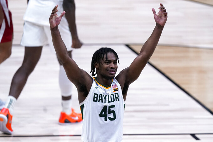 Baylor guard Davion Mitchell (45) celebrates beating Arkansas 81-72 after an Elite 8 game in the NCAA men's college basketball tournament at Lucas Oil Stadium, Tuesday, March 30, 2021, in Indianapolis. (AP Photo/Michael Conroy)