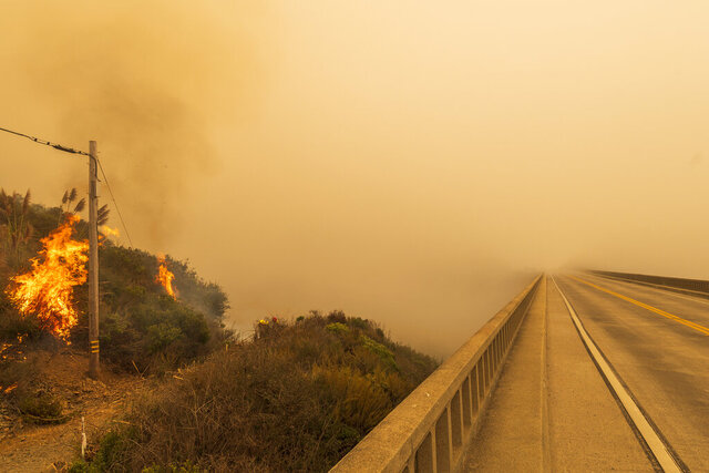Firefighters with Vandenberg Air Force Base, light a back burn to help control the Dolan Fire at Limekiln State Park in Big Sur, Calif,. Friday, Sept. 11, 2020. (AP Photo/Nic Coury)