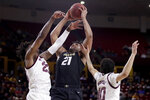 Colorado forward Evan Battey (21) battles Arizona State forward Romello White, left, and Jaelen House (10) for the rebound during the first half of an NCAA college basketball game, Thursday, Jan. 16, 2020, in Tempe, Ariz. (AP Photo/Matt York)