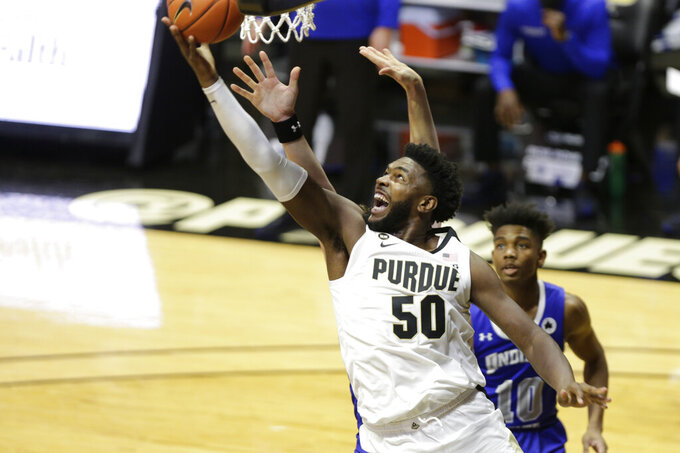Purdue forward Trevion Williams (50) goes up for a shot in front of Indiana State's Julian Larry during the first half of an NCAA college basketball game Saturday, Dec. 12, 2020, in West Lafayette, Ind. (Nikos Frazier/Journal & Courier via AP)