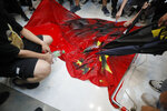 Protesters vandalize a Chinese national flag during a protest at a mall Sunday, Sept. 22, 2019, in Hong Kong. Hong Kong's pro-democracy protests, now in their fourth month, have often descended into violence in the evenings. A hardcore group of the protesters says the extreme actions are needed to get the government's attention. (AP Photo/Kin Cheung)