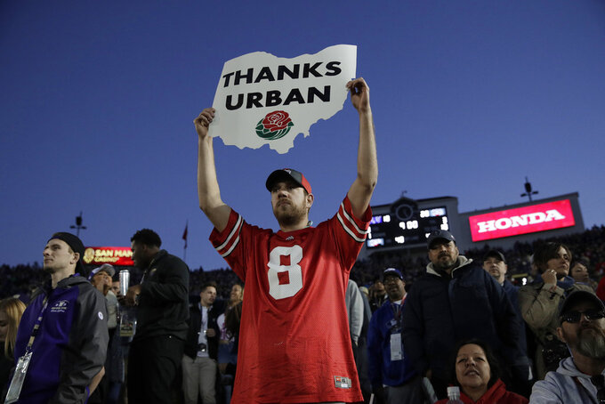 A fan shows support for Ohio State coach Urban Meyer during the second half of the team's Rose Bowl NCAA college football game against Washington on Tuesday, Jan. 1, 2019, in Pasadena, Calif. (AP Photo/Jae C. Hong)
