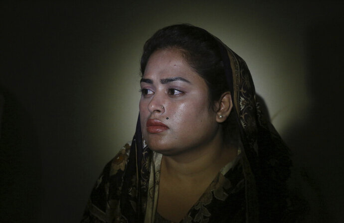 In this May 14, 2019, photo, Pakistani Christian Natasha Masih, speaks to the Associated Press in Faisalabad, Pakistan. Natasha begged her mother to bring her home from China, but it took an elaborate scheme devised by a small cabal of Christian men in her hometown of Faisalabad, in Pakistan's Punjab province, to orchestrate her escape from what began as an unhappy marriage, and ended in prostitution. (AP Photo/K.M. Chaudary)