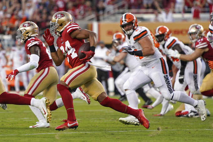 San Francisco 49ers defensive back K'Waun Williams (24) returns an interception against the Cleveland Browns during the first half of an NFL football game in Santa Clara, Calif., Monday, Oct. 7, 2019. (AP Photo/Tony Avelar)
