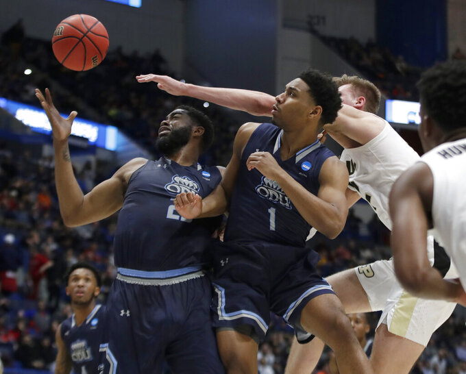 Old Dominion's Elbert Robinson III, left, and Jason Wade (1) compete for a rebound with Purdue's Matt Haarms, back right, during the first half of a first-round game in the NCAA men's college basketball tournament Thursday, March 21, 2019, in Hartford, Conn. (AP Photo/Elise Amendola)