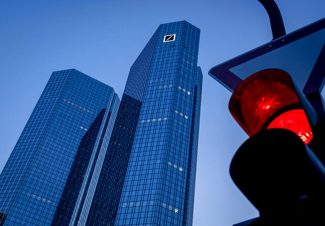 The headquarters of Deutsche Bank is seen in Frankfurt, Germany, Monday, May 18, 2020. The bank will hold a virtual annual shareholders meeting in Wednesday. (AP Photo/Michael Probst)