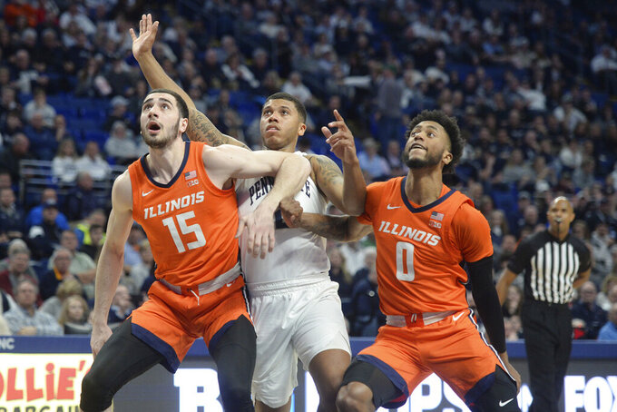 Penn State's Myles Dread, center is blocked from a rebound by Illinois' Giorgi Bezhanishvili (15) and Alan Griffin (0) during the first half of an NCAA college basketball game Tuesday, Feb. 18, 2020, in State College, Pa. (AP Photo/Gary M. Baranec)