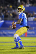 UCLA quarterback Dorian Thompson-Robinson looks for a receiver during the first half of the team's NCAA college football game against California on Saturday, Nov. 30, 2019, in Pasadena, Calif. (AP Photo/Mark J. Terrill)