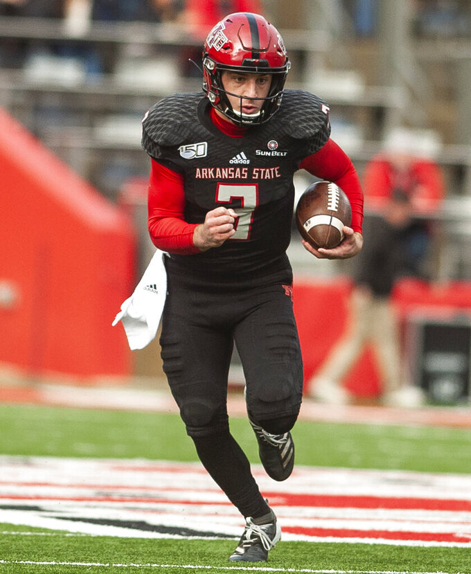 Arkansas State quarterback Layne Hatcher runs with the ball during the first half of an NCAA college football game against Georgia Southern, Saturday, Nov. 23, 2019, at Centennial Bank Stadium in Jonesboro, Ark. (Quentin Winstine/The Jonesboro Sun via AP)