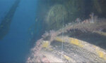 In this image taken from video, the top hatch of a conning tower can be seen from a submarine wreck somewhere in the Strait of Malacca on March 4, 2020. Divers have found what they believe is the wreck of a U.S. Navy submarine lost 77 years ago in Southeast Asia, providing a coda to a stirring but little-known tale from World War II. (Jean Luc Rivoire via AP)