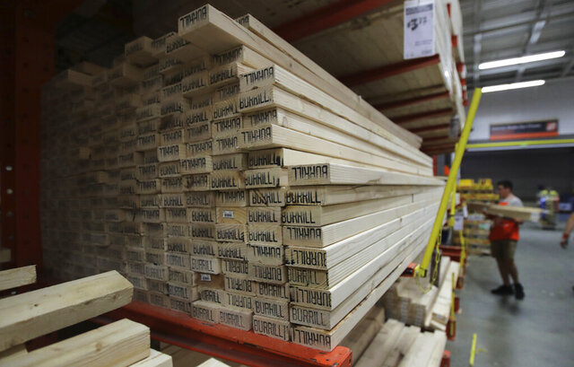 FILE - In this July 11, 2019, file photo lumber is stacked at the Home Depot store in Londonderry, N.H. Don't let your desire to upgrade your home downgrade your home's market value. Before you make a renovation fantasy a reality, consider whether the project will pay off when you're ready to sell. (AP Photo/Charles Krupa, File)