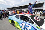 FILE - In this June 22, 2020, file photo, Bubba Wallace takes a selfie of himself and of other drivers who had pushed his car to the front in the pits at Talladega Superspeedway before the NASCAR Cup Series auto race in Talladega Ala., Monday June 22, 2020. The noose found hanging in Wallace's garage stall at Talladega had been there since at least last October, federal authorities said Tuesday, June 23, in announcing there will be no charges filed in an incident that rocked NASCAR and its only fulltime Black driver. (AP Photo/John Bazemore, File)