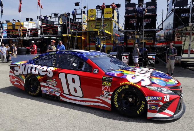 Kyle Busch drives to the track during a practice for the NASCAR Sprint Cup Series auto race at Chicagoland Speedway in Joliet, Ill., Saturday, June 29, 2018. (AP Photo/Nam Y. Huh)