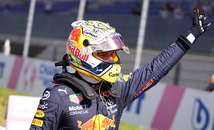 Red Bull driver Max Verstappen of the Netherlands celebrates after winning the qualifying at the Red Bull Ring racetrack in Spielberg, Austria, Saturday, June 26, 2021. The Styrian Formula One Grand Prix will be held on Sunday, June 27, 2021. (AP Photo/Darko Vojinovic, Pool)