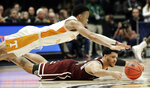 Tennessee guard Lamonte Turner, top, and Mississippi State guard Quinndary Weatherspoon, bottom, dive for a loose ball in the second half of an NCAA college basketball game at the Southeastern Conference tournament Friday, March 15, 2019, in Nashville, Tenn. Tennessee won 83-76. (AP Photo/Mark Humphrey)