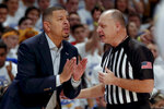 Pittsburgh head coach Jeff Capel, left, talks with an official about a foul call as his team plays against North Carolina during the first half of an NCAA college basketball game, Saturday, Jan. 18, 2020, in Pittsburgh. Pittsburgh won 66-52.(AP Photo/Keith Srakocic)
