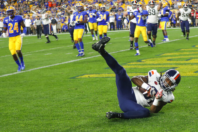 Virginia running back Chris Sharp (31) rolls over in the end zone after making a touchdown catch against Pittsburgh in the first quarter of an NCAA college football game Saturday, Aug. 31, 2019, in Pittsburgh. (AP Photo/Keith Srakocic)