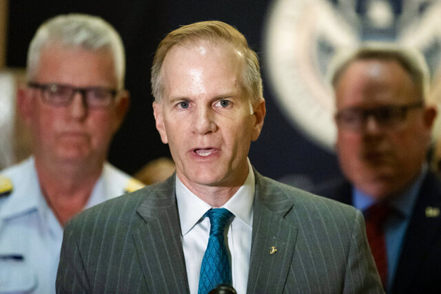 FILE - In this June 21, 2019 file photo, U.S. Attorney for the Eastern District of Pennsylvania William McSwain speaks with members of the media at a news conference in Philadelphia.  McSwain, the top federal prosecutor in Philadelphia announced Thursday, Jan. 14, 2021 that he will step down next week when President Trump leaves office.  (AP Photo/Matt Rourke, File)
